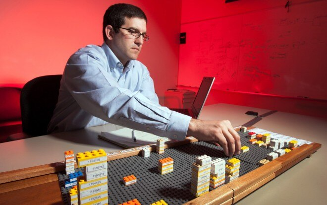 General Motors LEGO Tracking System Engineer Putting Bricks On Board1 660x413