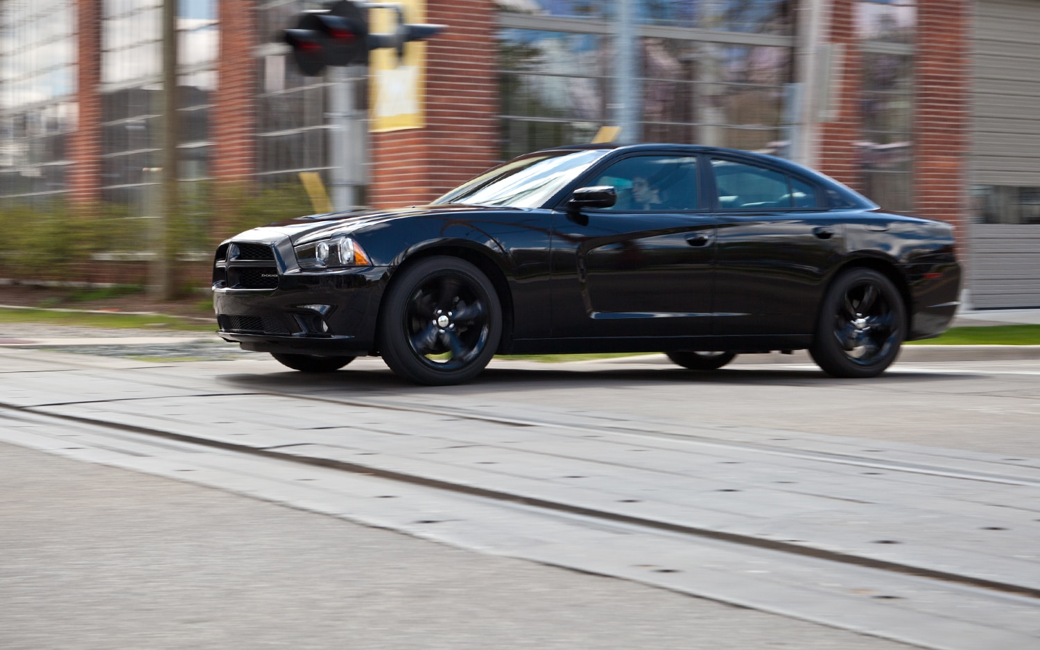 2012 Dodge Charger SXT Plus Side In Motion1