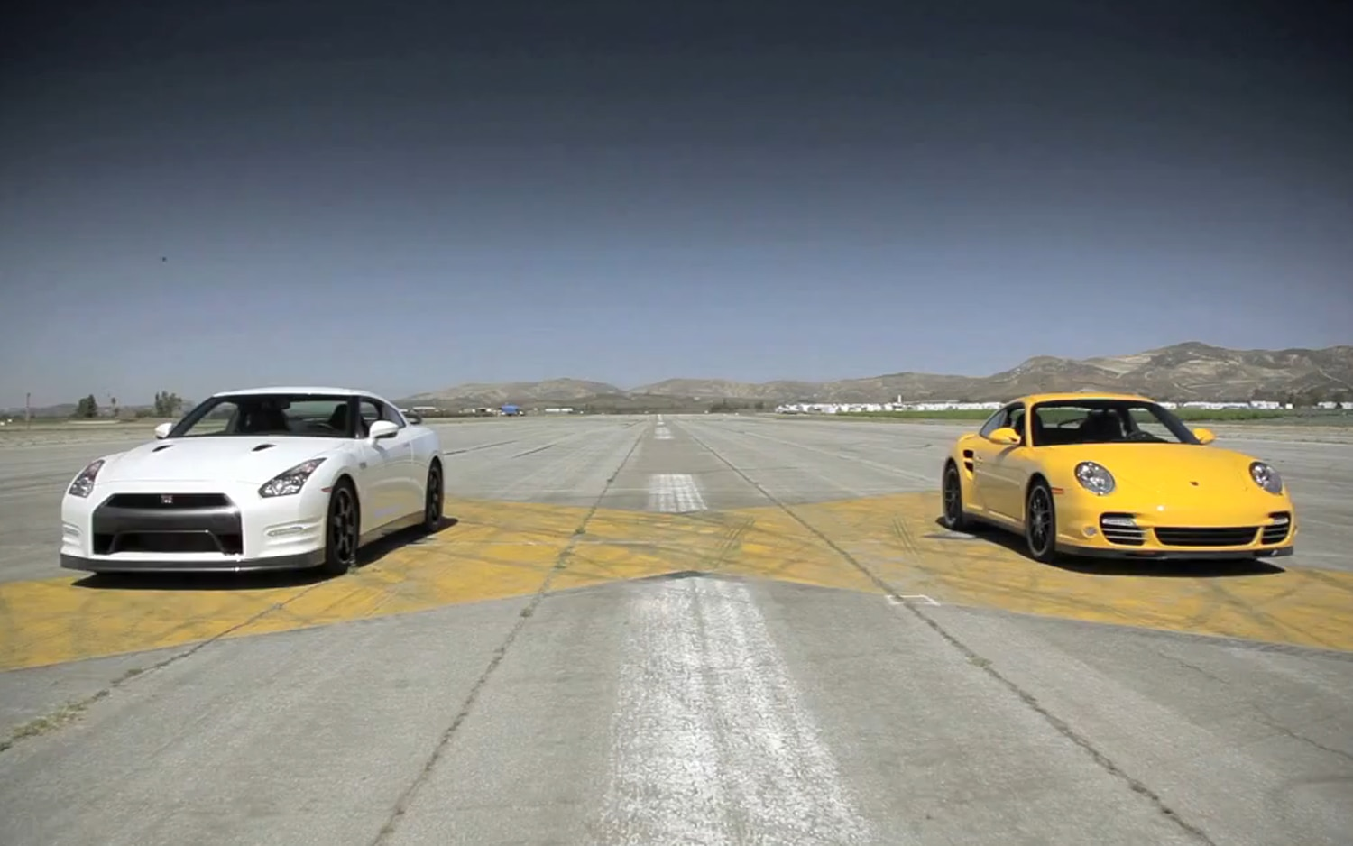 2013 Nissan GT R Black Edition Vs 2012 Porsche 911 Turbo S Front View Drag Strip1