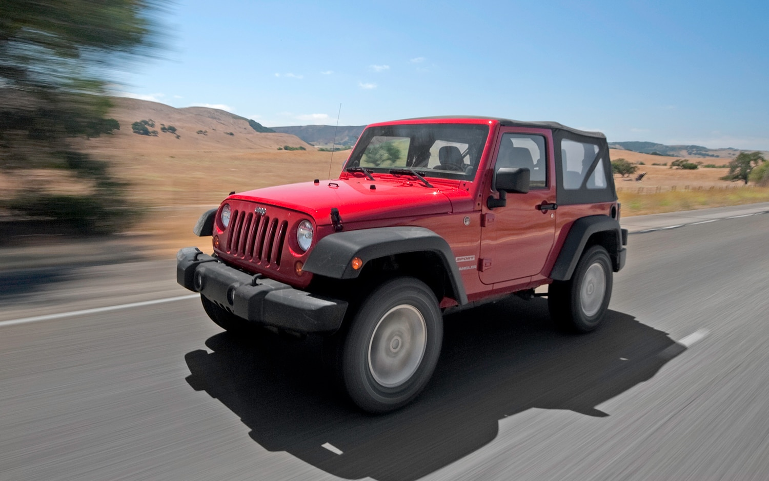 2012 Jeep Wrangler Sport Front View In Motion