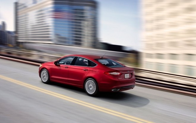 2013 Ford Fusion Rear Three Quarters In Motion1 660x413