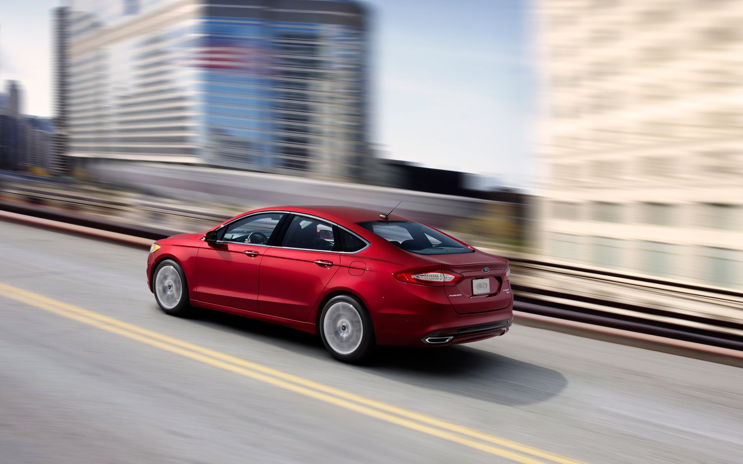 2013 Ford Fusion Rear Three Quarters In Motion1