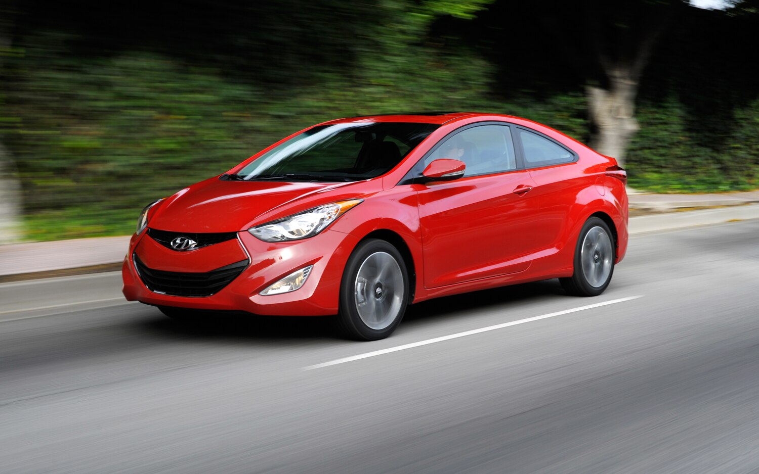 2013 Hyundai Elantra Coupe Front Three Quarter In Motion1