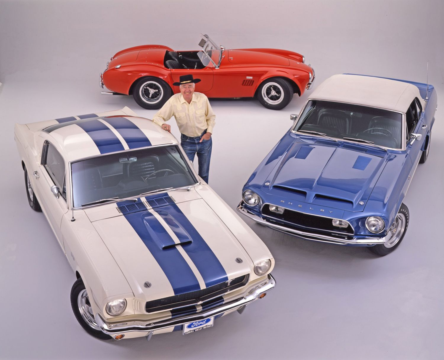 Carroll Shelby With Mustangs And Cobra1