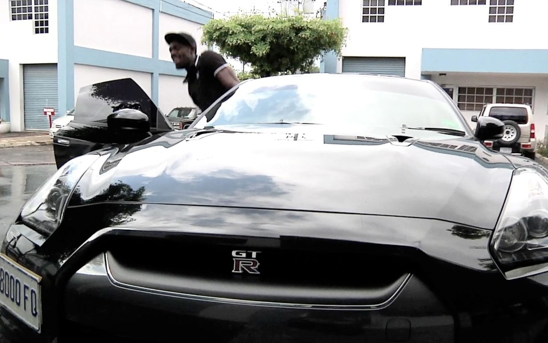 Usain Bolt With Black Nissan GT R1