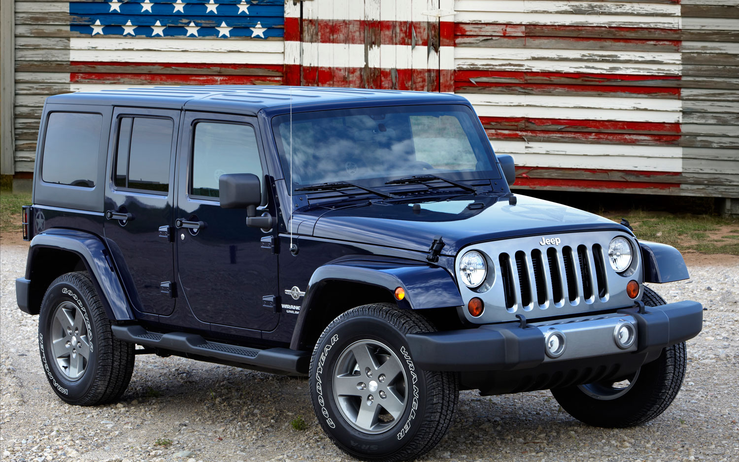 2012-Jeep-Wrangler-Freedom-Edition-front-three-quarter-in-front-of-American-flag