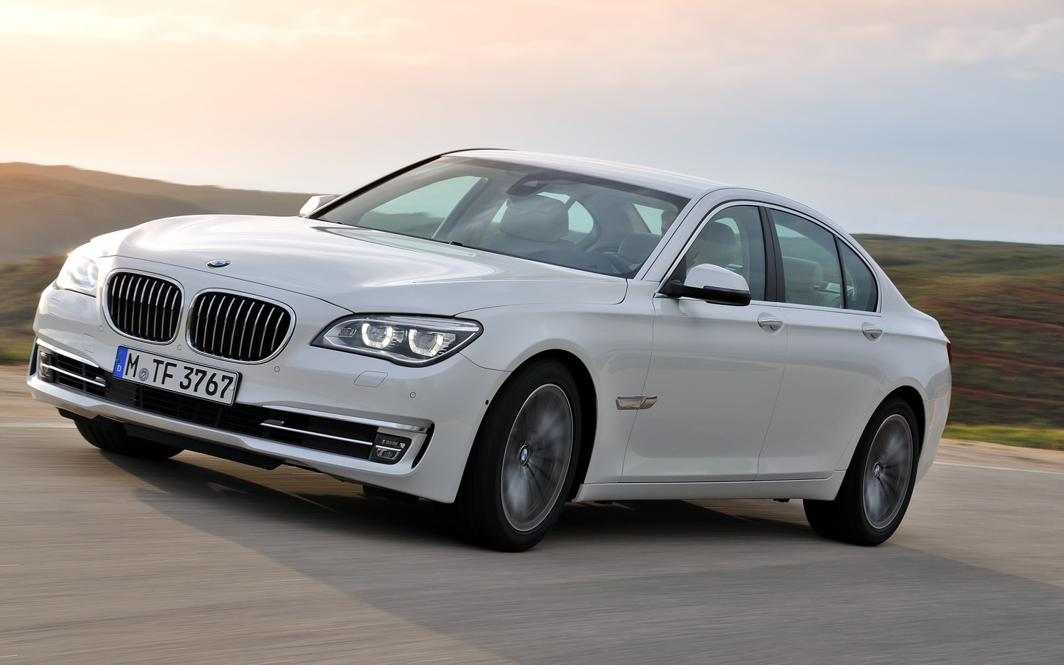2013 BMW 7 Series Front Three Quarter Left Front Quarter In Motion1