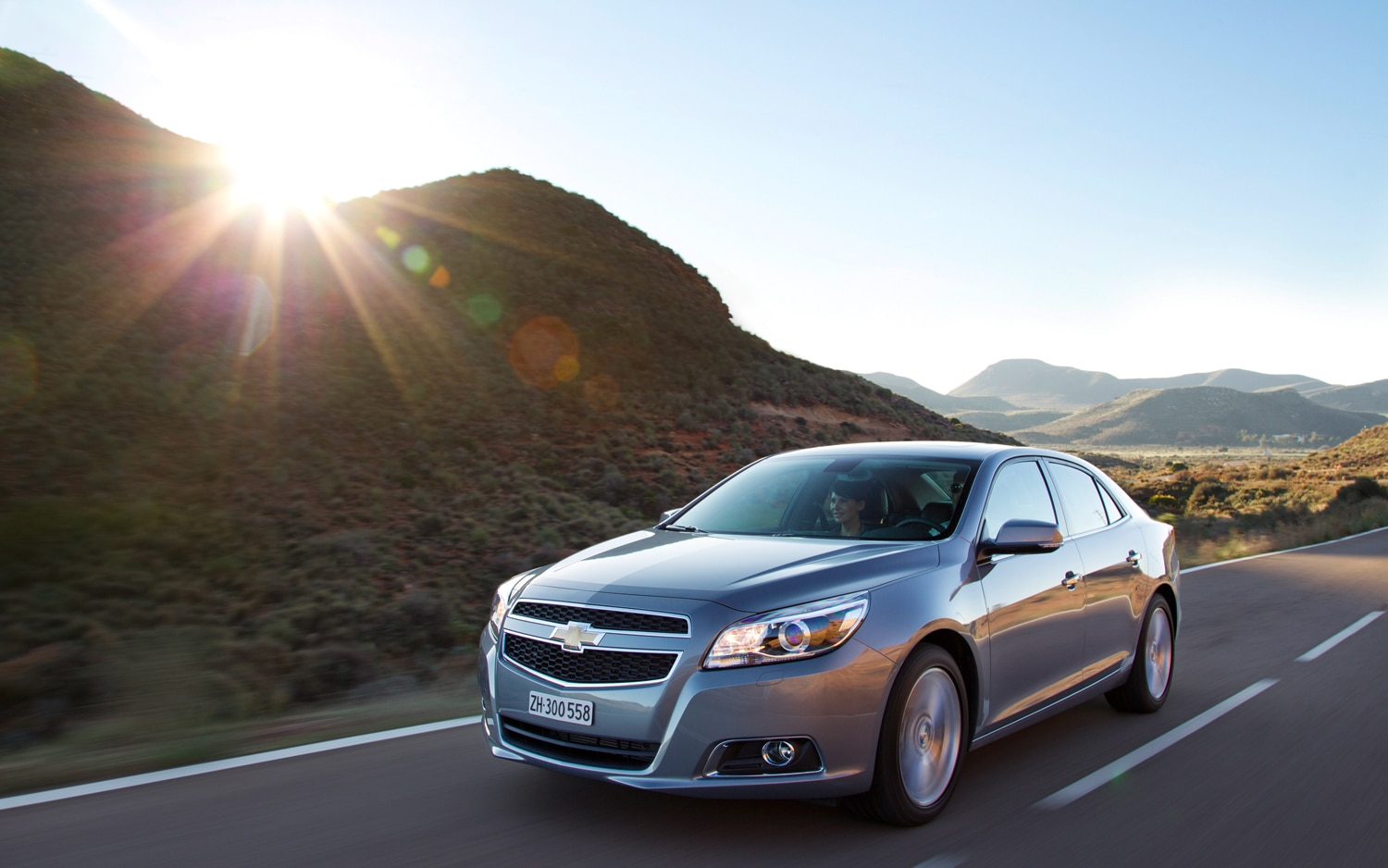 2013 Chevrolet Malibu Front Three Quarter In Motion1