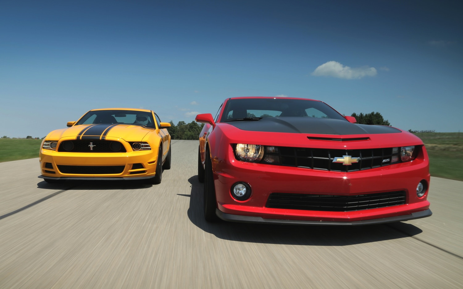 2013 Ford Mustang Boss 302 Vs 2013 Chevrolet Camaro SS 1LE Front View 21