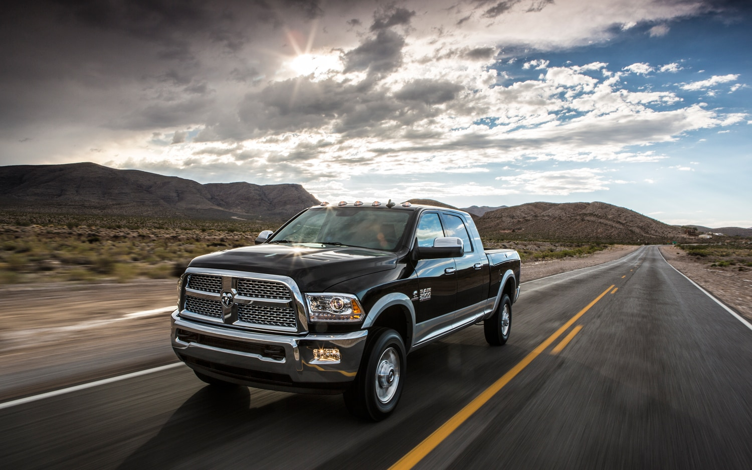 2013 Ram Heavy Duty Pickup Front Three Quarters In Motion1