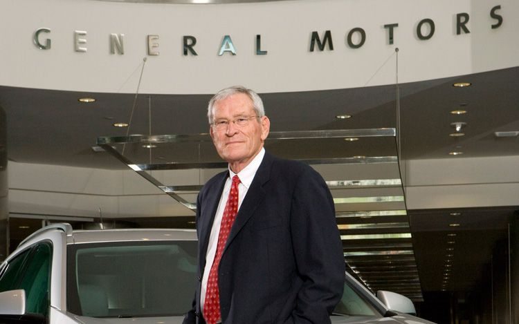 Former GM CEO Ed Whitacre In Front Of General Motors Sign