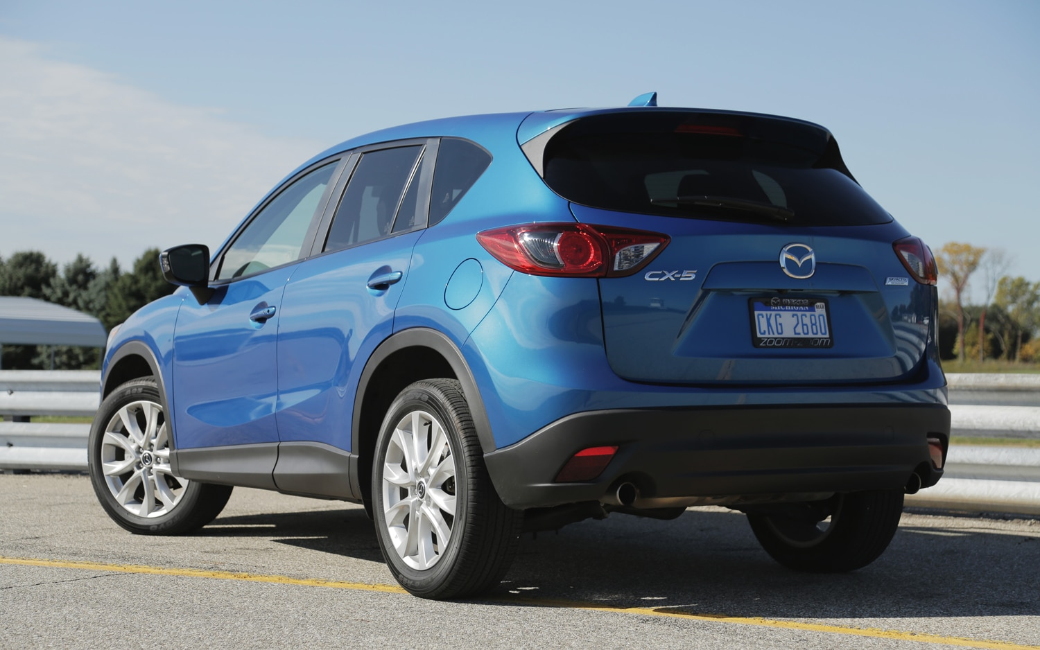 http://st.automobilemag.com/uploads/sites/11/2012/11/2013-Mazda-CX-5-Grand-Touring-rear-left-view.jpg