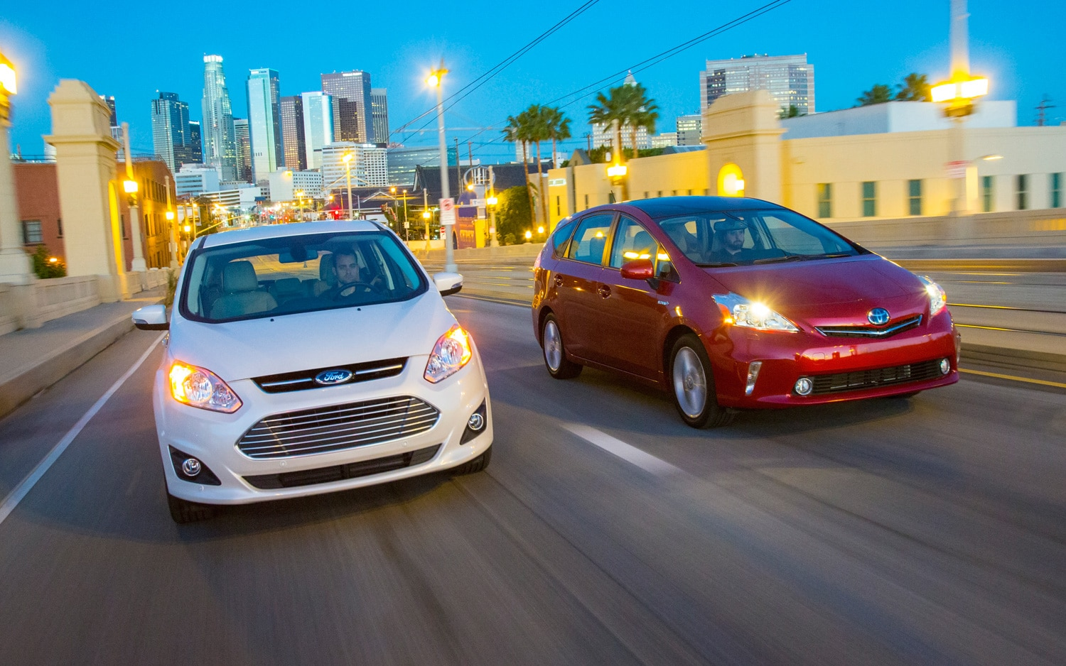 Ford C Max And Toyota Prius V In Motion1