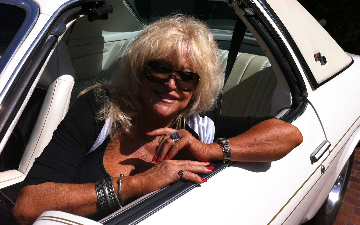 Miss Hurst Golden Shifter In Her Vintage 1975 Hurst Olds