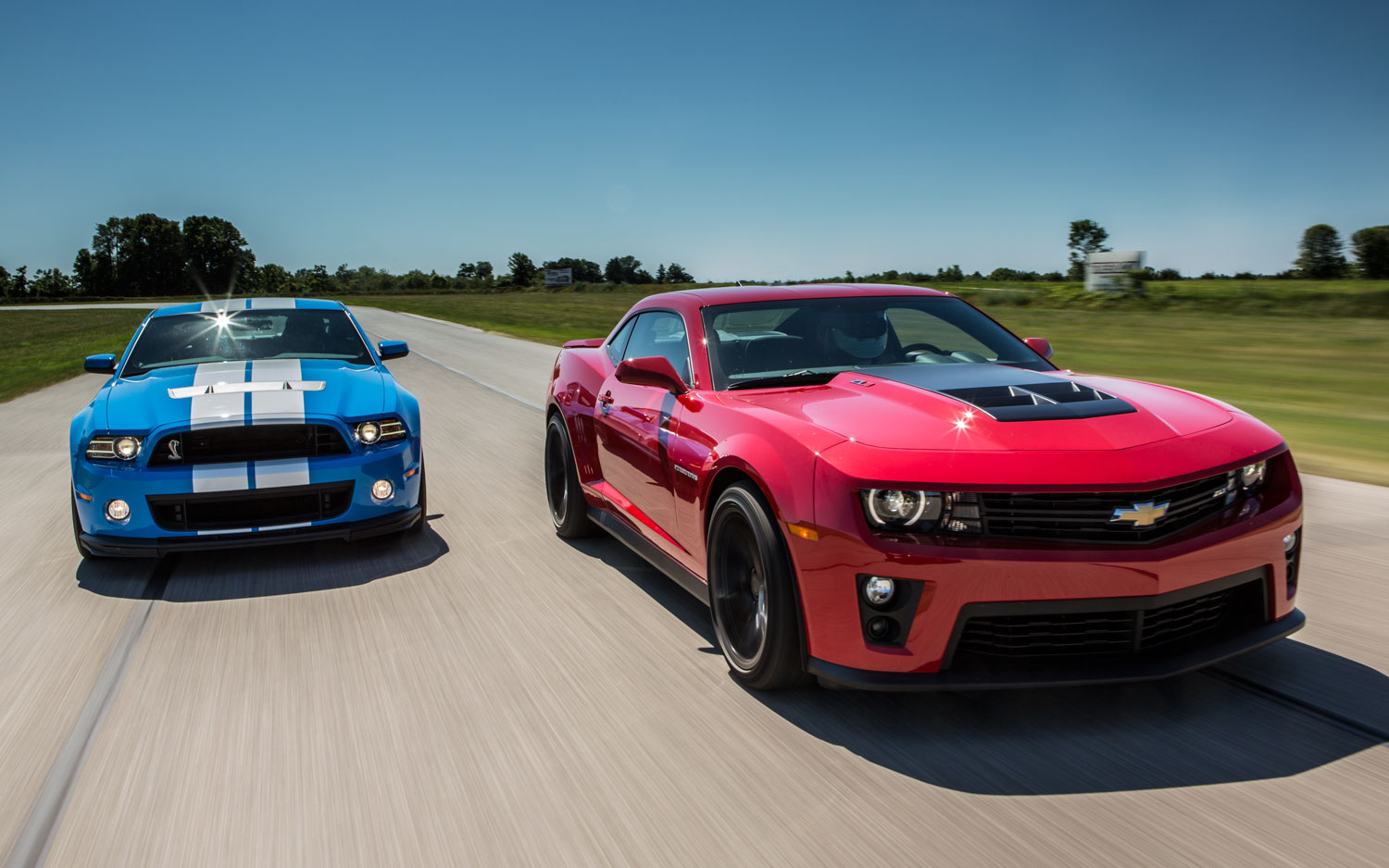 2012 Chevrolet Camaro ZL1 And 2013 Ford Shelby GT500 Front View On Track1