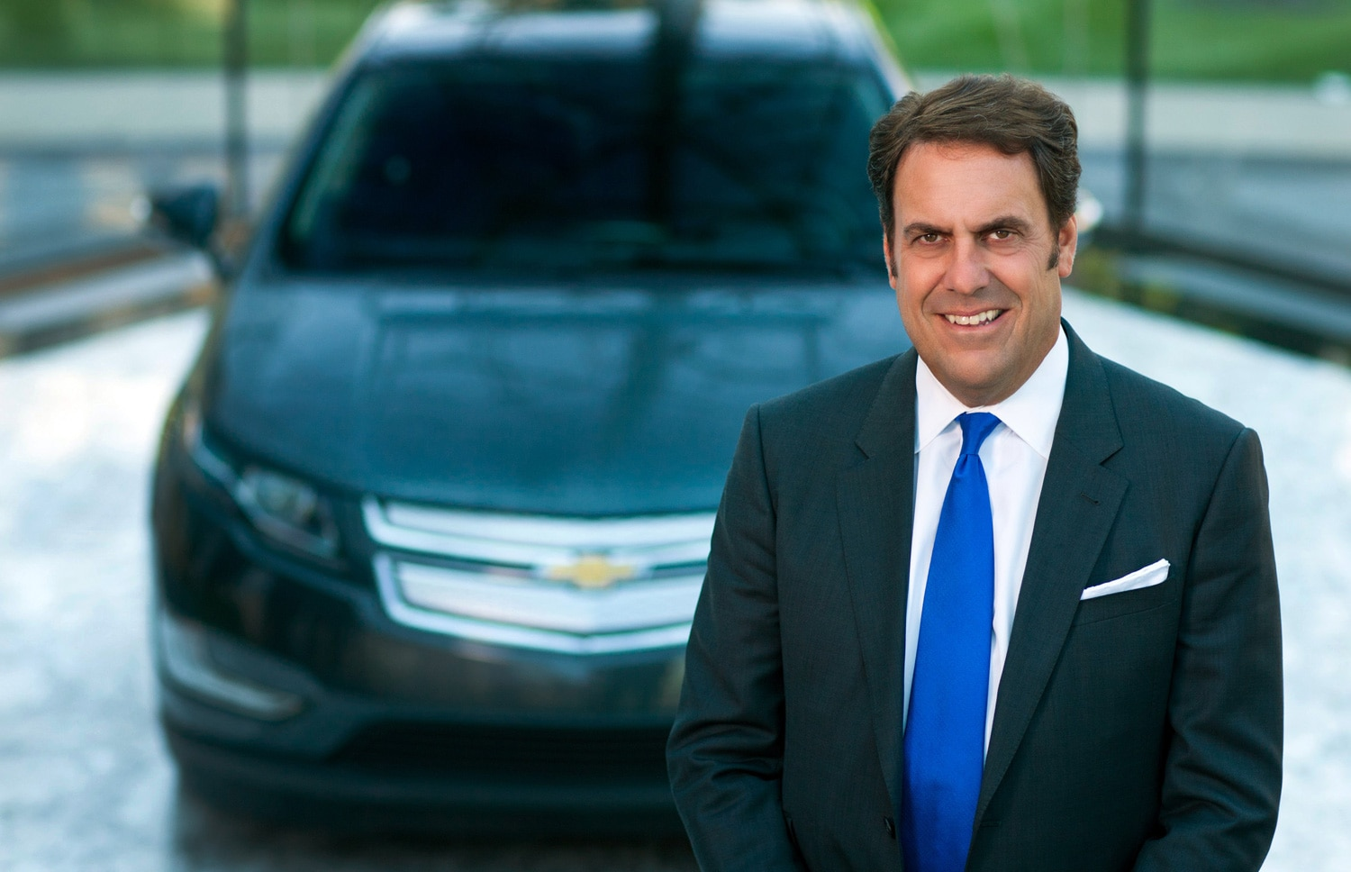 Mark Reuss With Chevrolet Volt In Background