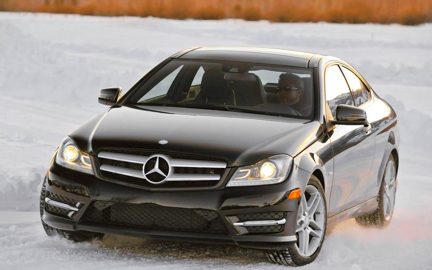 2012 Mercedes Benz C350 Coupe Front Three Quarter Snow1