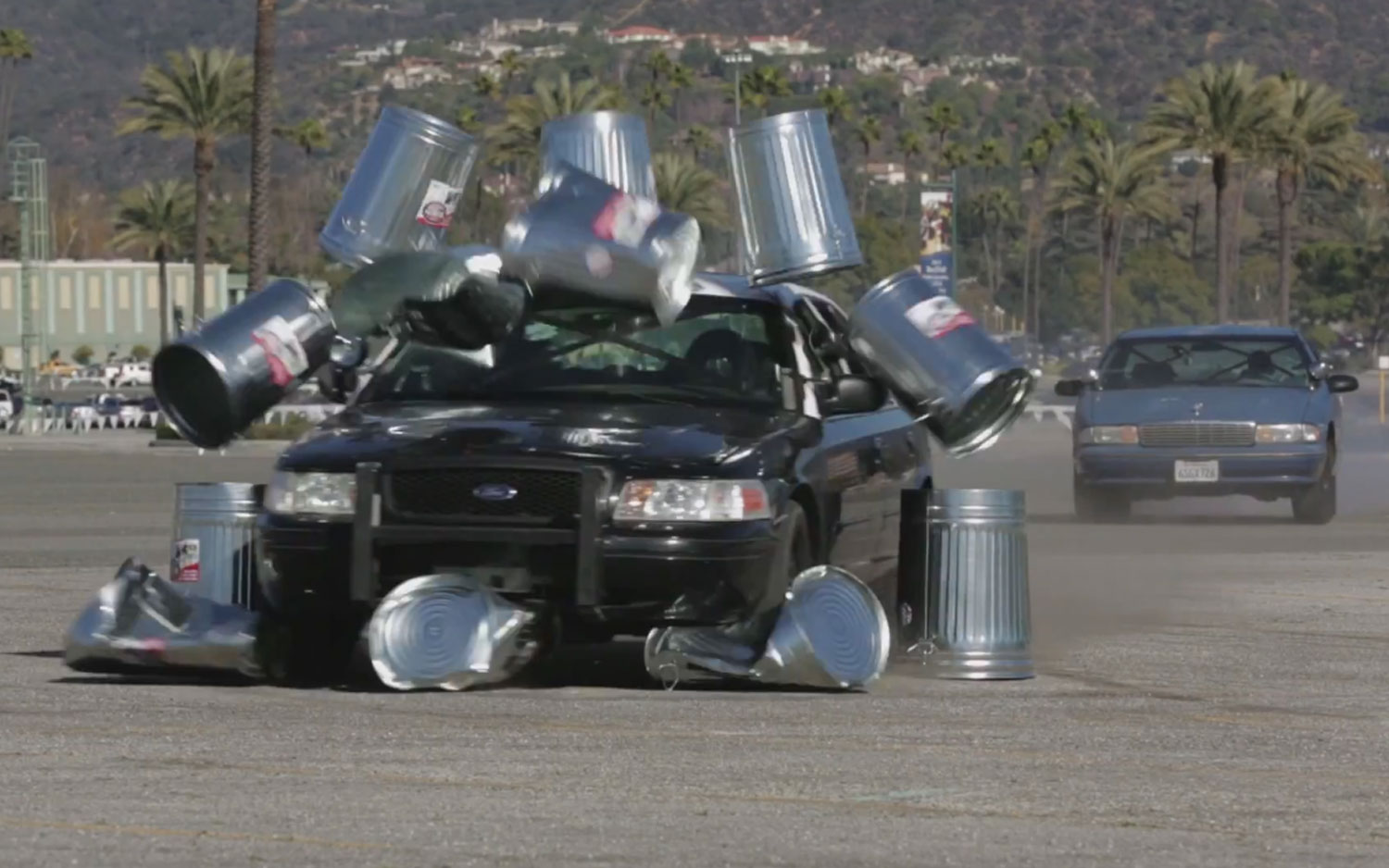 Ford Crown Victoria P71 Cop Car Plowing Through Trash Cans1