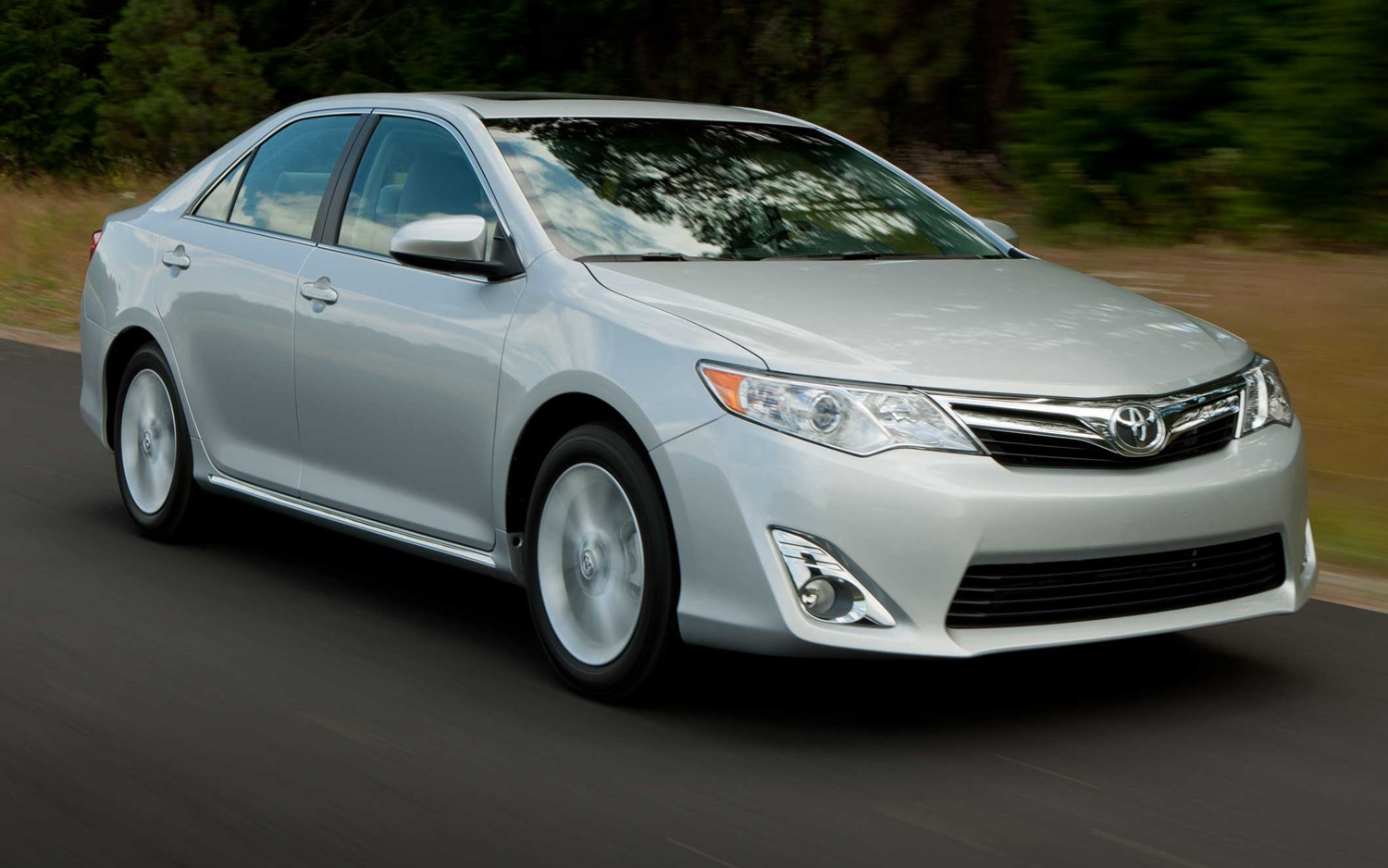 2013 Toyota Camry Front Three Quarters In Motion1