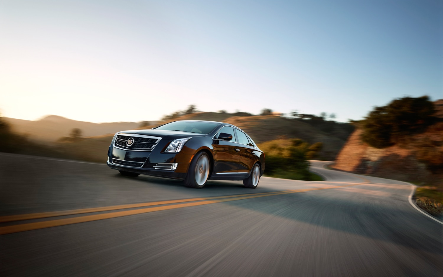 2014 Cadillac XTS Turbo Front Three Quarter In Motion1