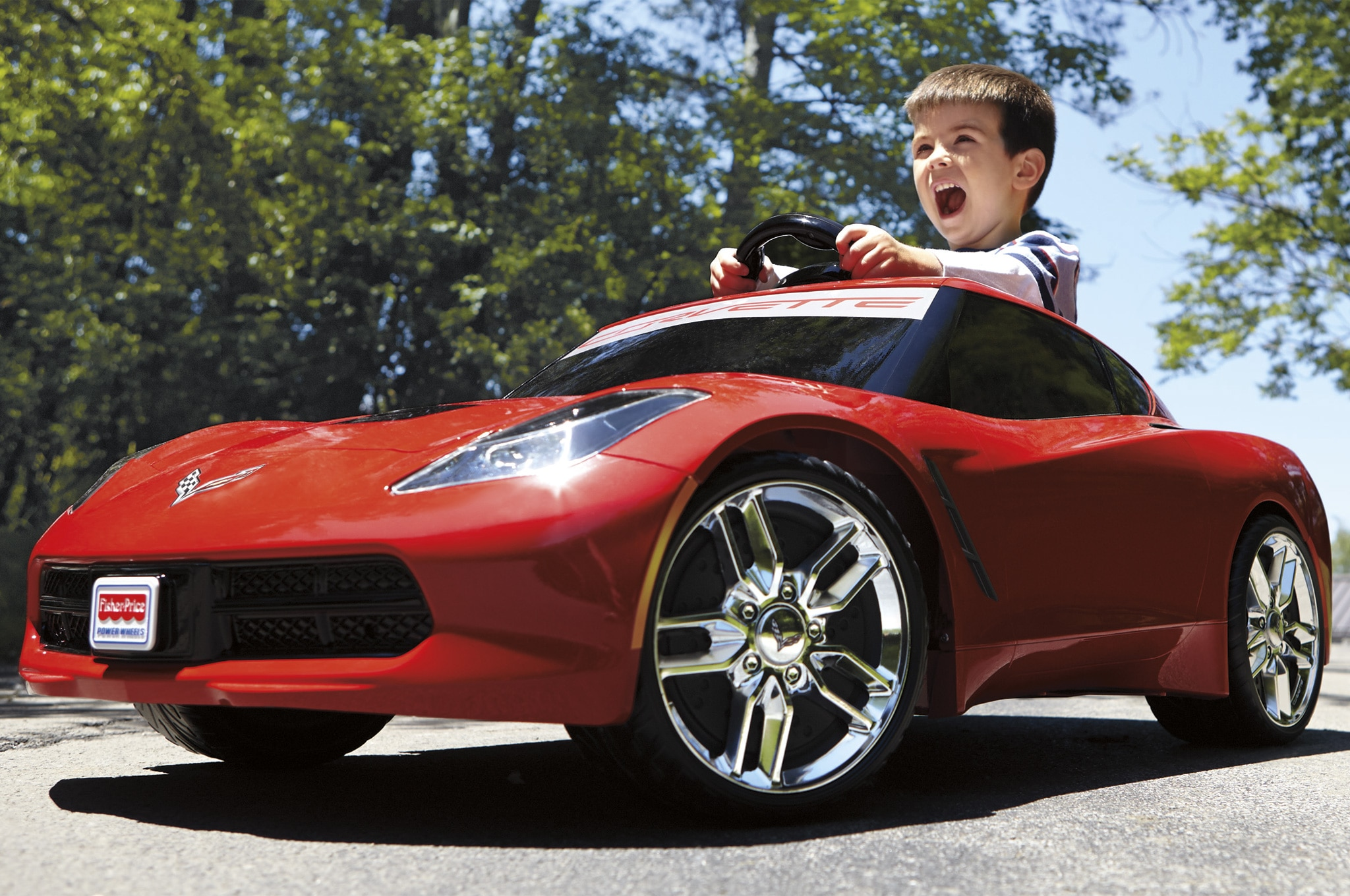 Power Wheels 2014 Chevrolet Corvette C7 Front Three Quarters View With Screaming Kid1