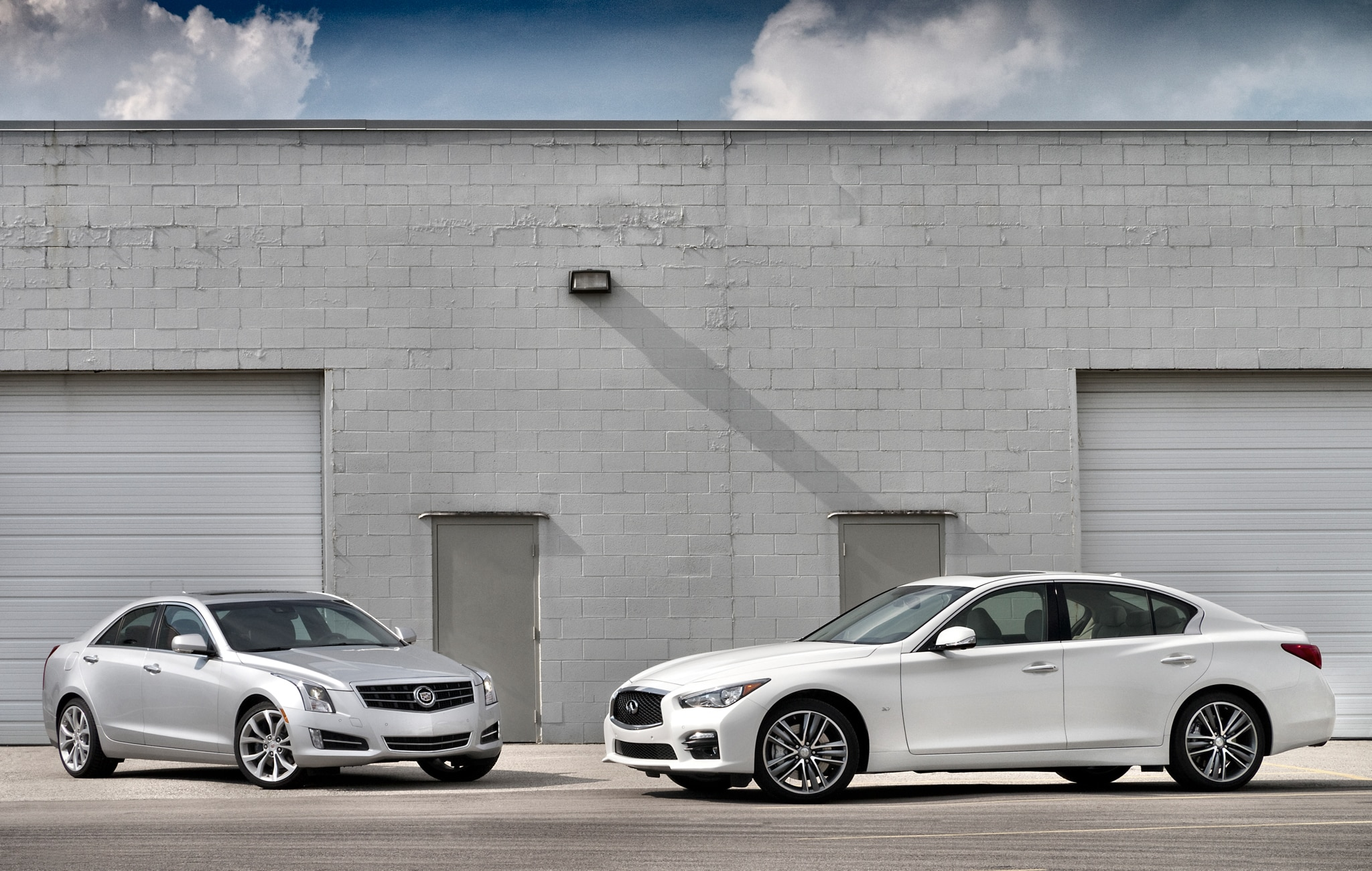 2013 Cadillac ATS And 2014 Infiniti Q50 Parked1