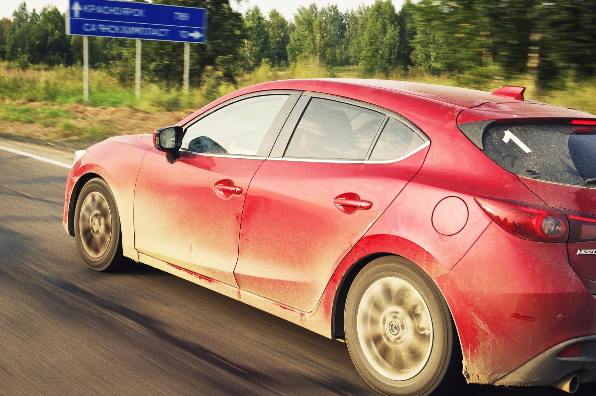 2014 Mazda 3 Left Rear Angle Driving Russia1