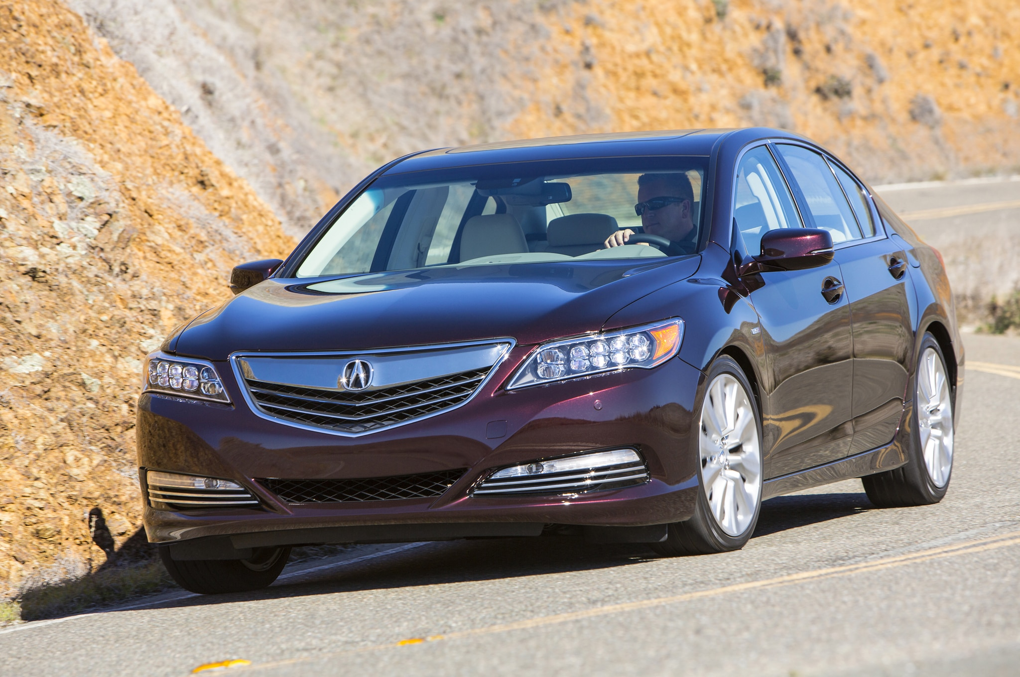 2014 Acura RLX Sport Hybrid Front Three Quarters In Motion 051