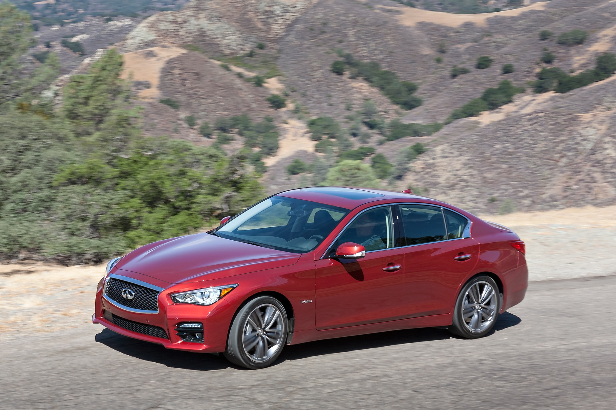 2014 Infiniti Q50 Hybrid Sport Drivers Side Above In Motion1