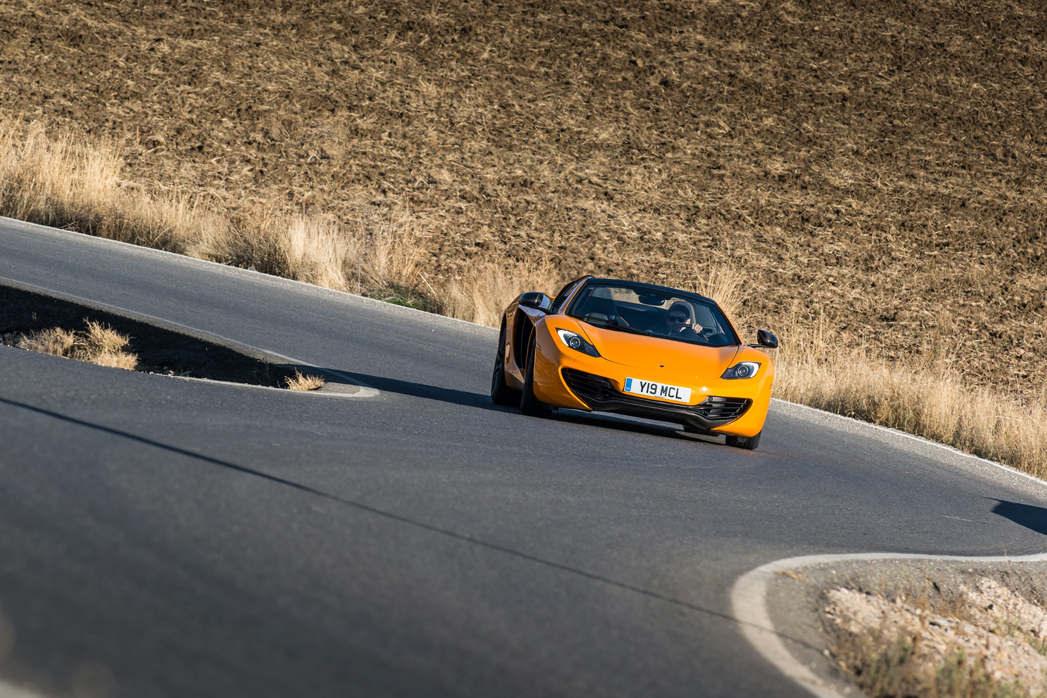 2013 McLaren 12C Spider Profile Front View In Motion Open 11