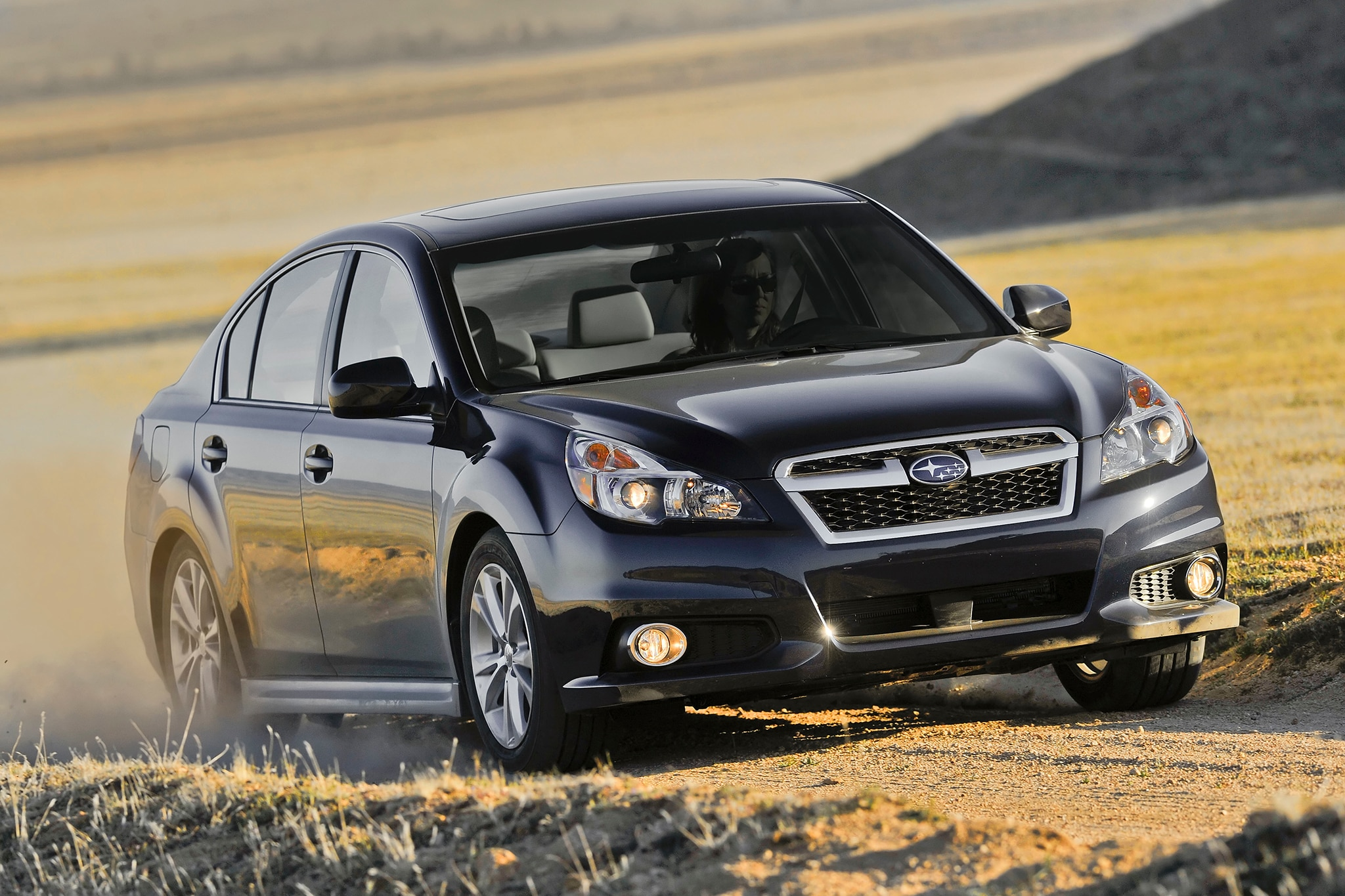 2014 Subaru Legacy Three Quarters In Motion Offroad1