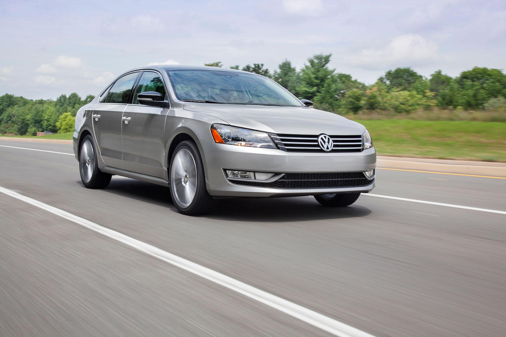 2014 Volkswagen Passat Sport Front Passengers Side In Motion1