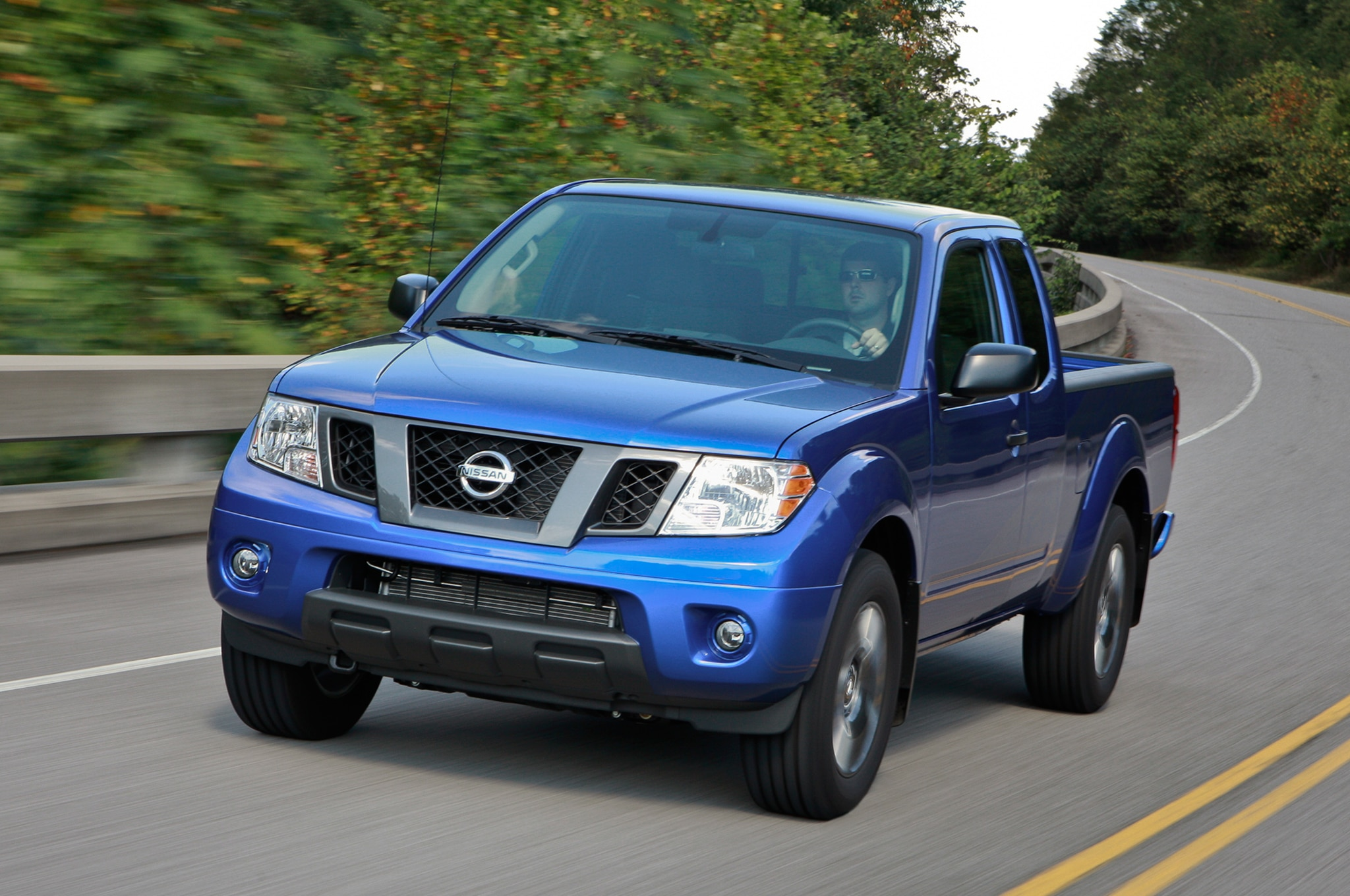 2013 Nissan Frontier King Cab Three Quarters In Motion View1