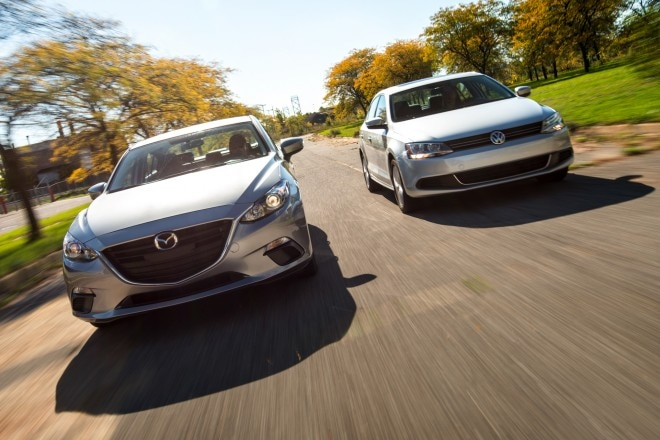 2014 Mazda 3 And 2014 Volkswagen Jetta Front View In Motion 22 660x440