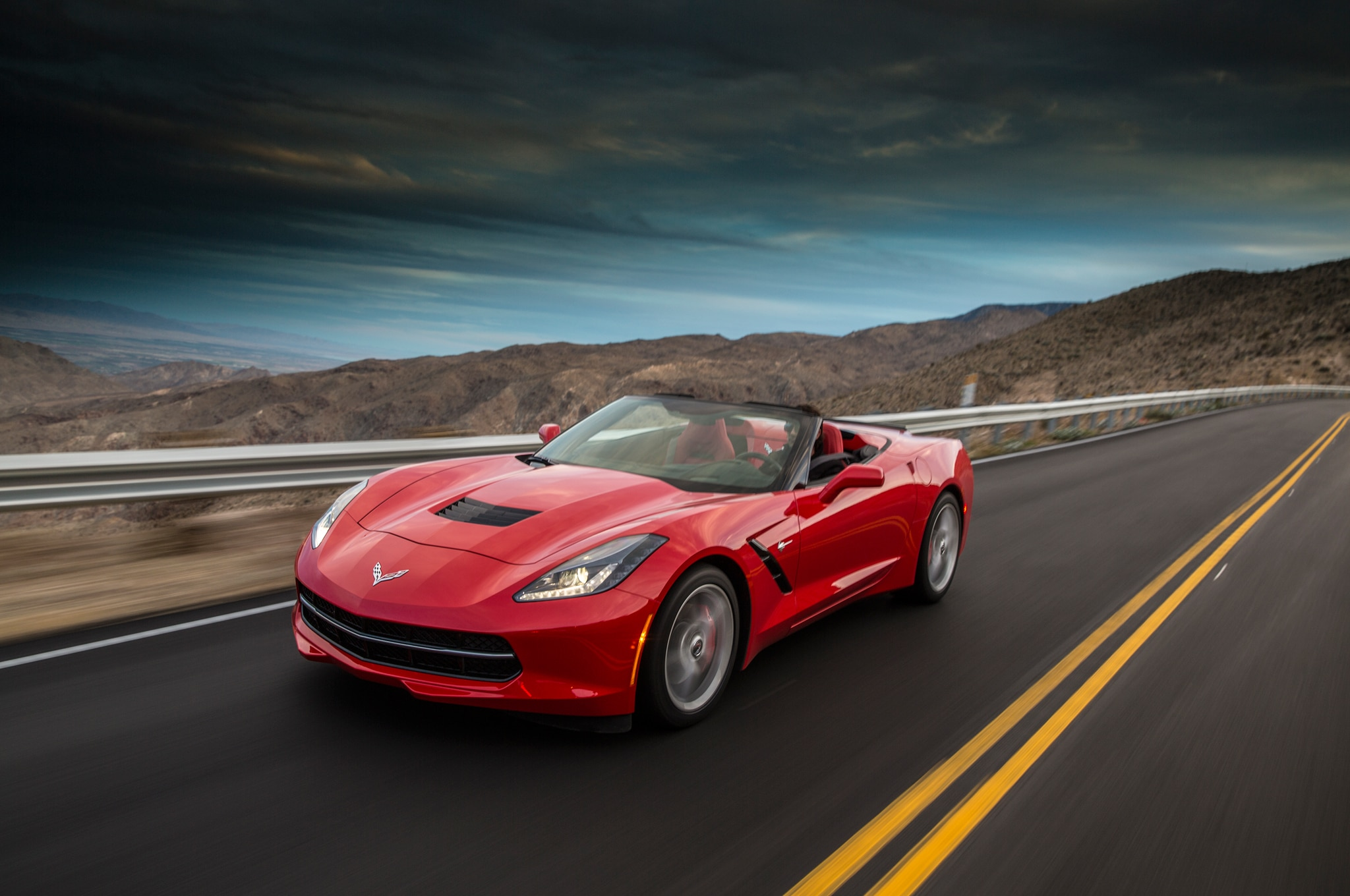 2014 chevrolet corvette stingray convertible red front end in motion 051
