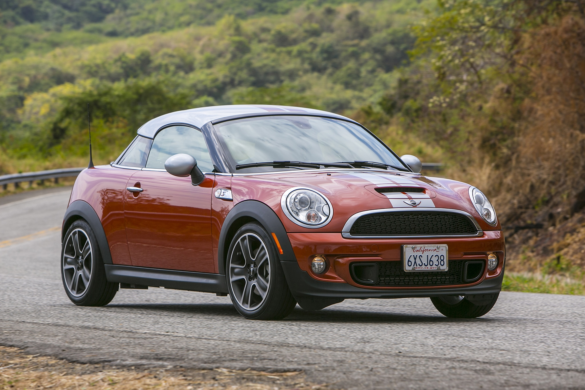 2014 MINI Cooper Coupe Three Quarters In Motion1