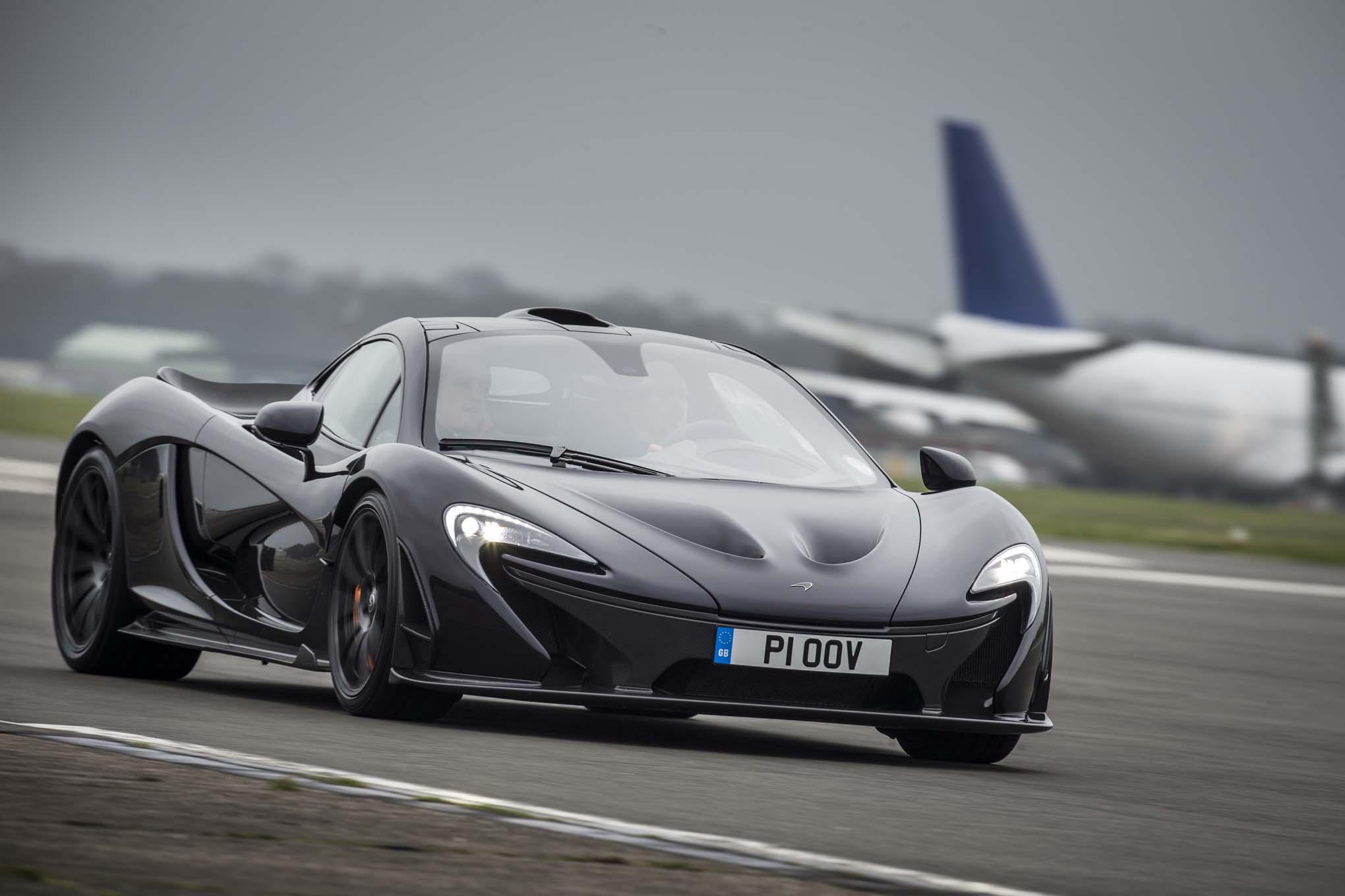 http://st.automobilemag.com/uploads/sites/11/2014/03/2014-Mclaren-P1-black-front-end-in-motion-02.jpg