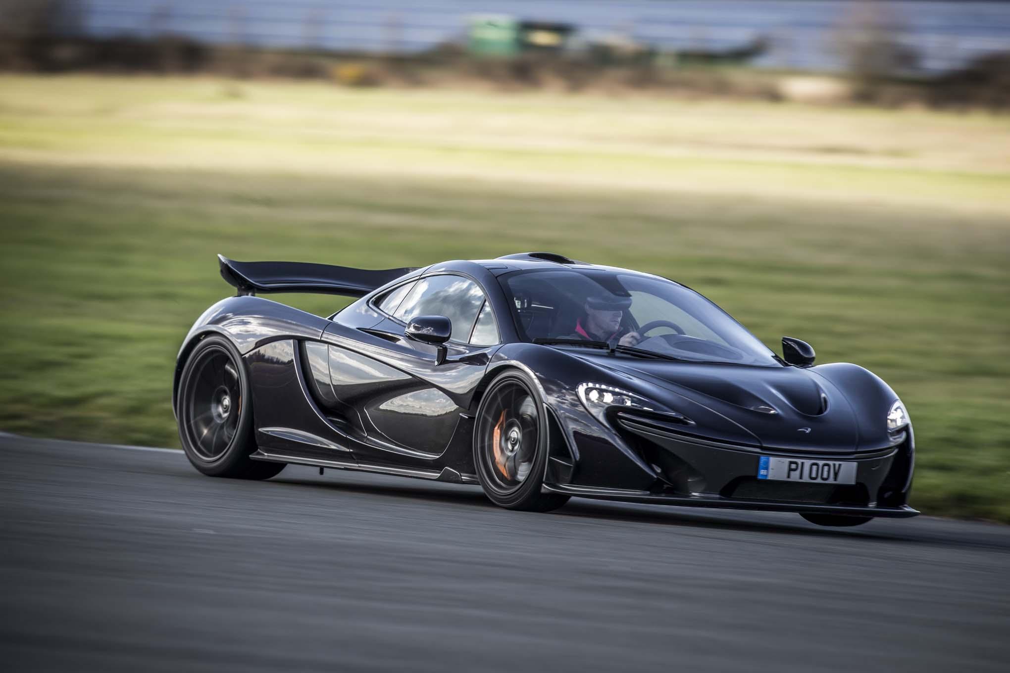 http://st.automobilemag.com/uploads/sites/11/2014/03/2014-Mclaren-P1-black-front-three-quarter-in-motion-10.jpg