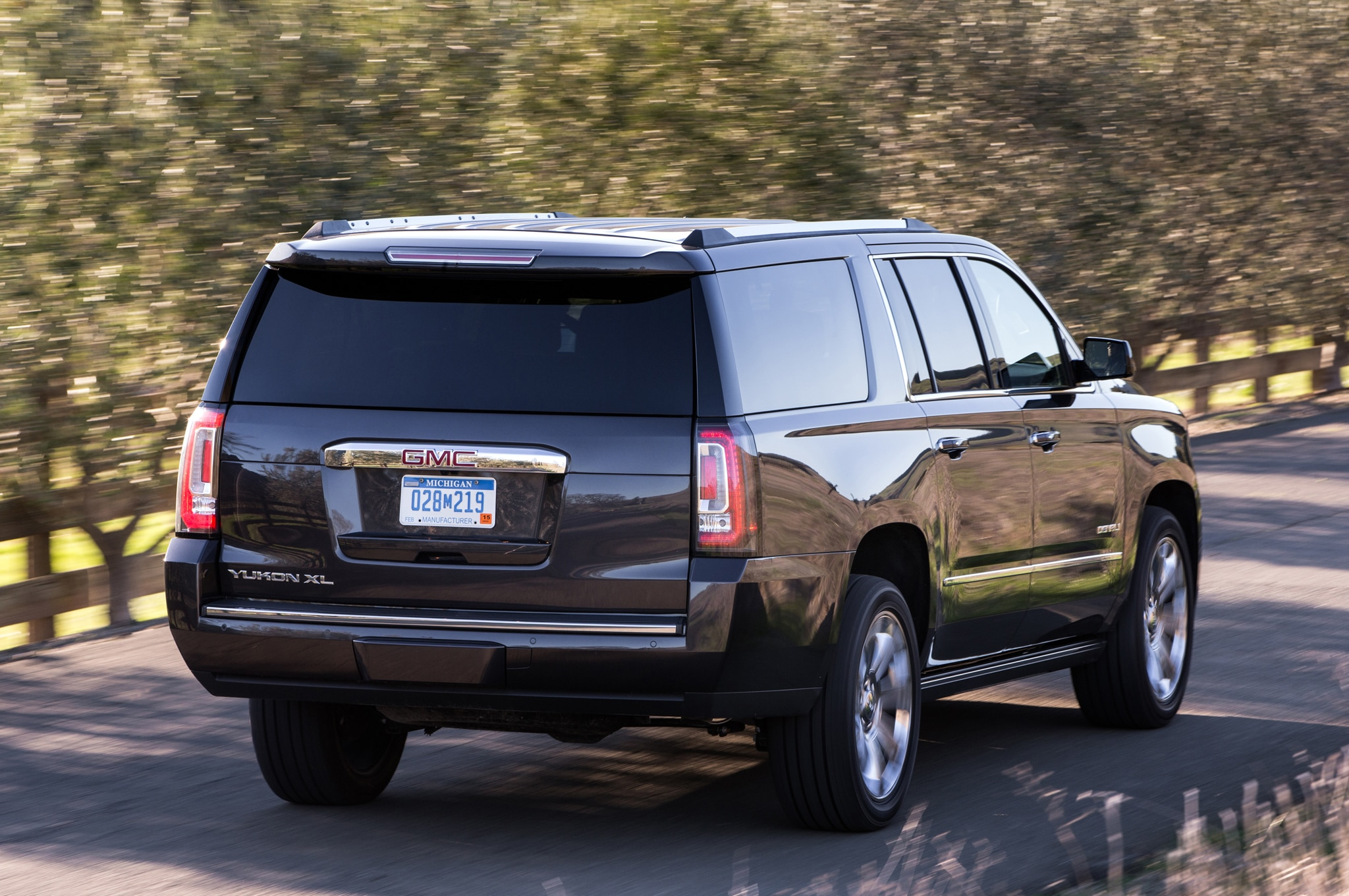 gmc cars truth yukon the of capsule review front denali about