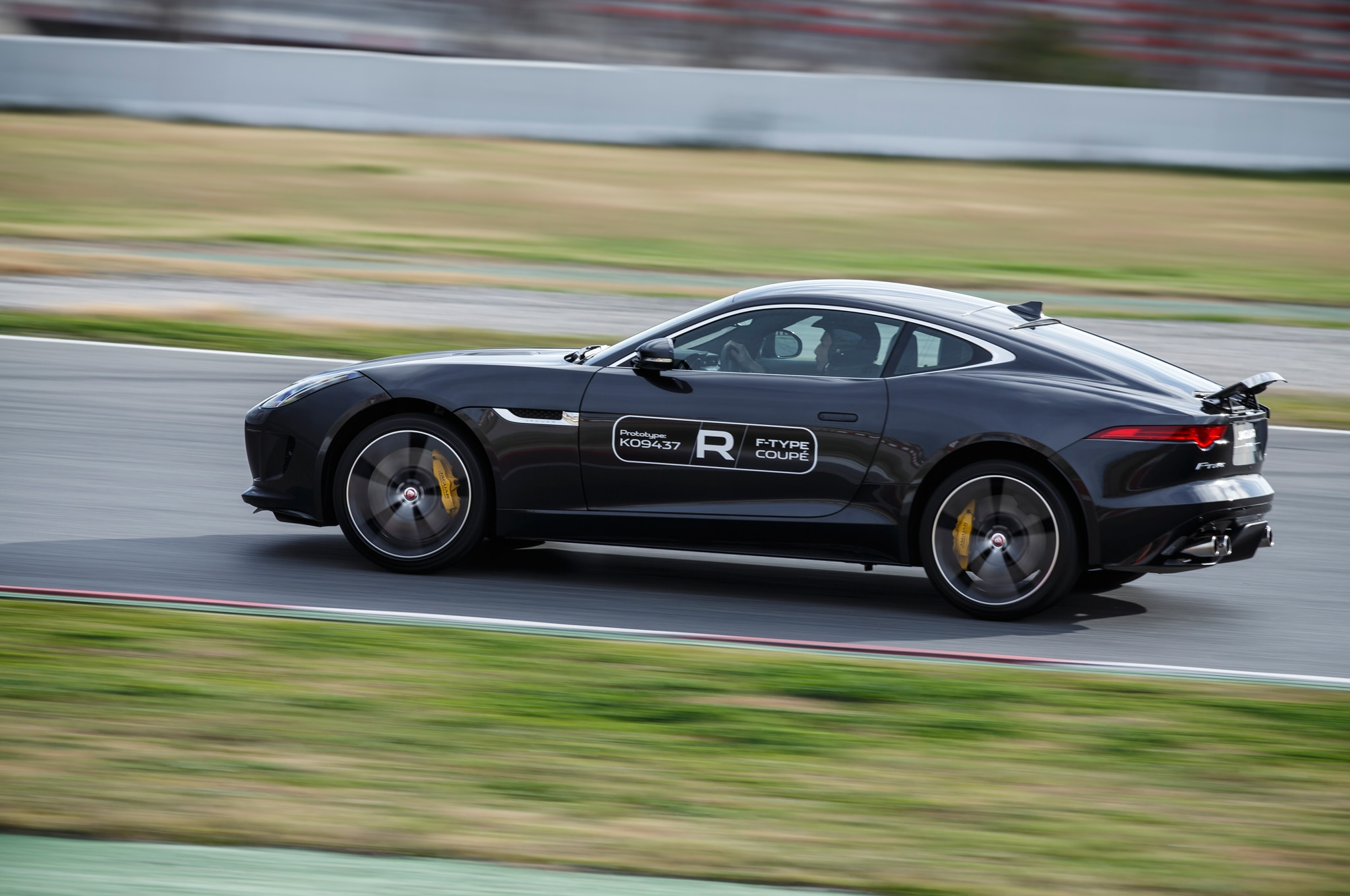 2015 Jaguar F Type Coupe Side Rear Profile In Motion1