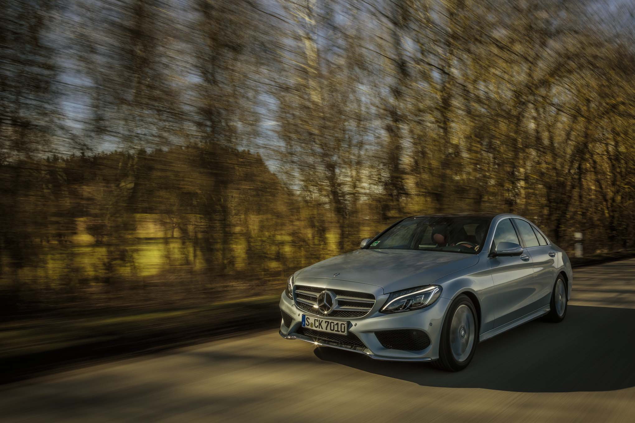 2015 Mercedes Benz C Class Front Three Quarter In Motion 021