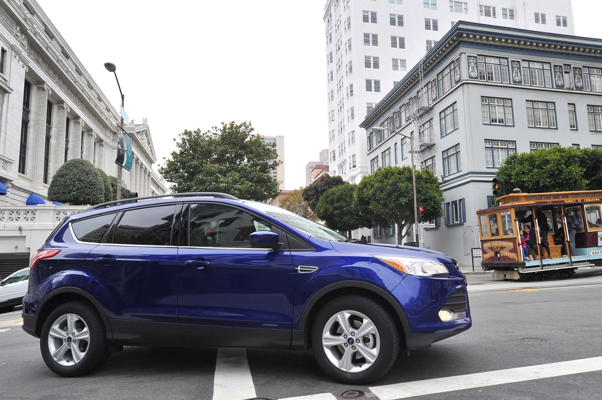 2013 Ford Escape Side Profile In Motion 21