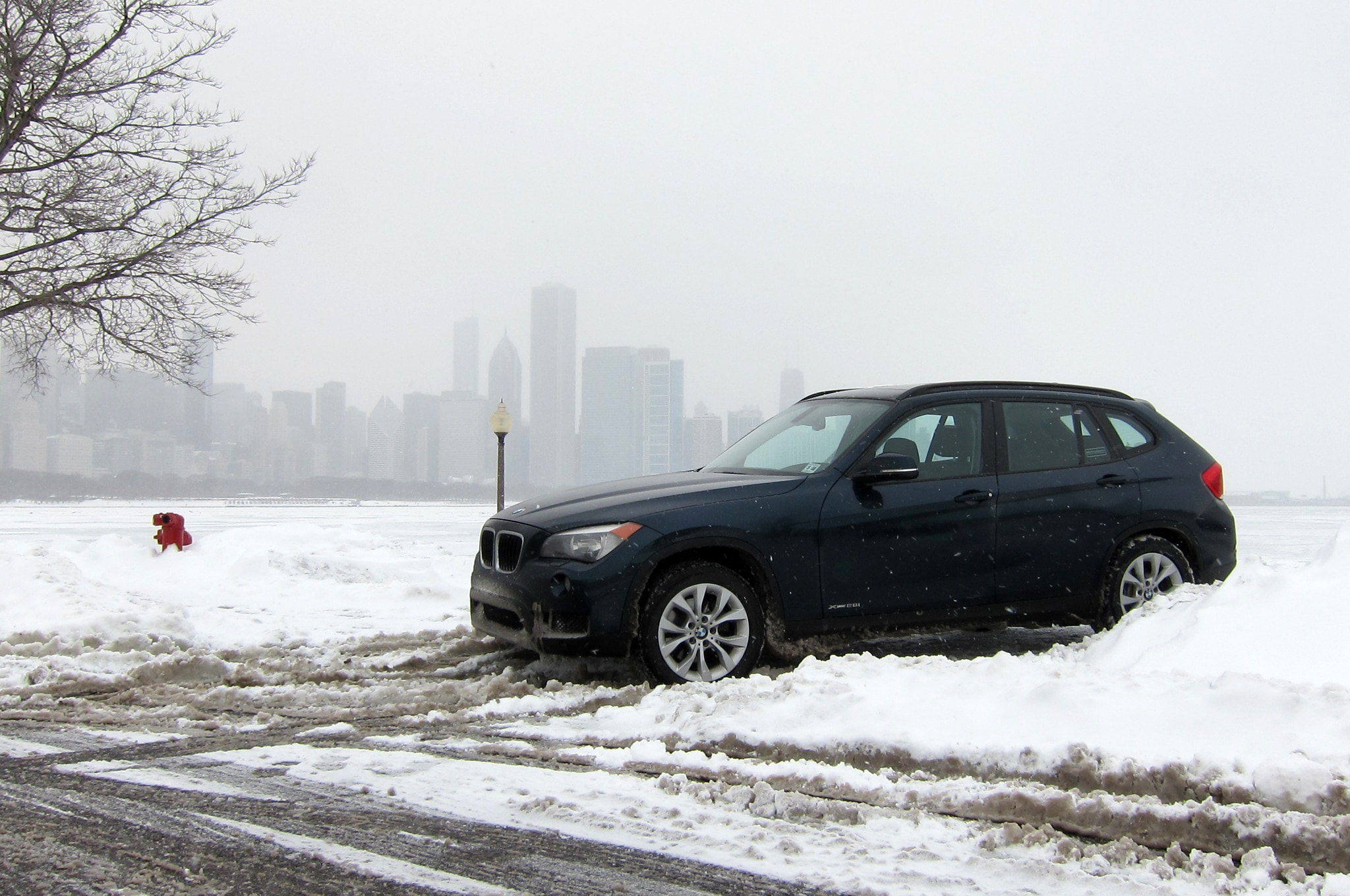 2013 Bmw X1 Front Three Quarter Snow1