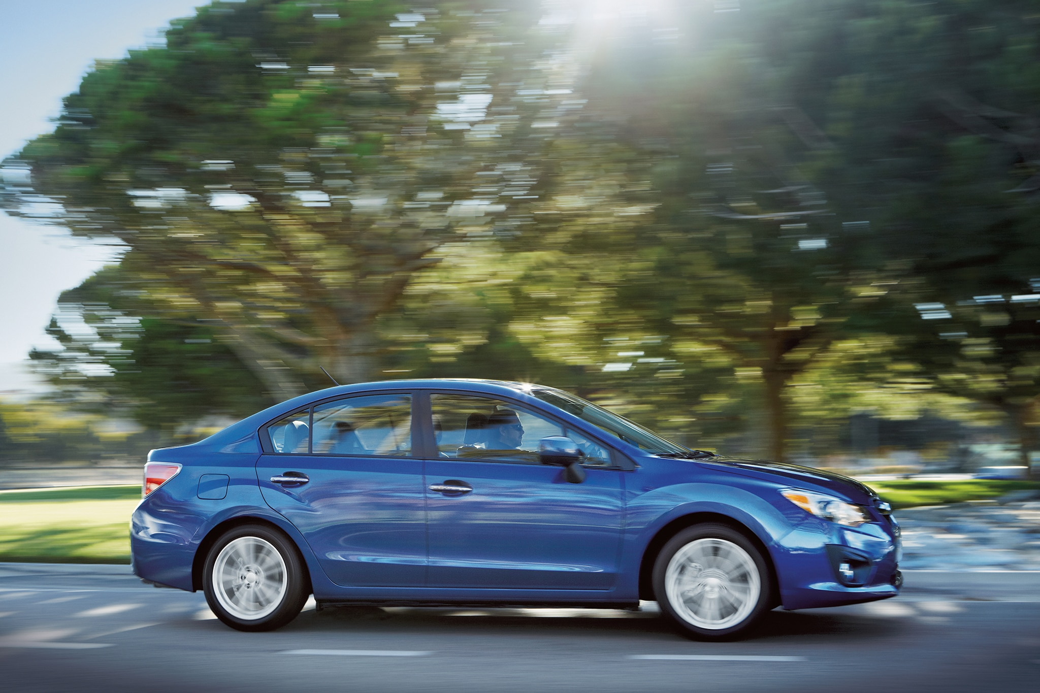 2014 Subaru Impreza Passengers Side In Motion1