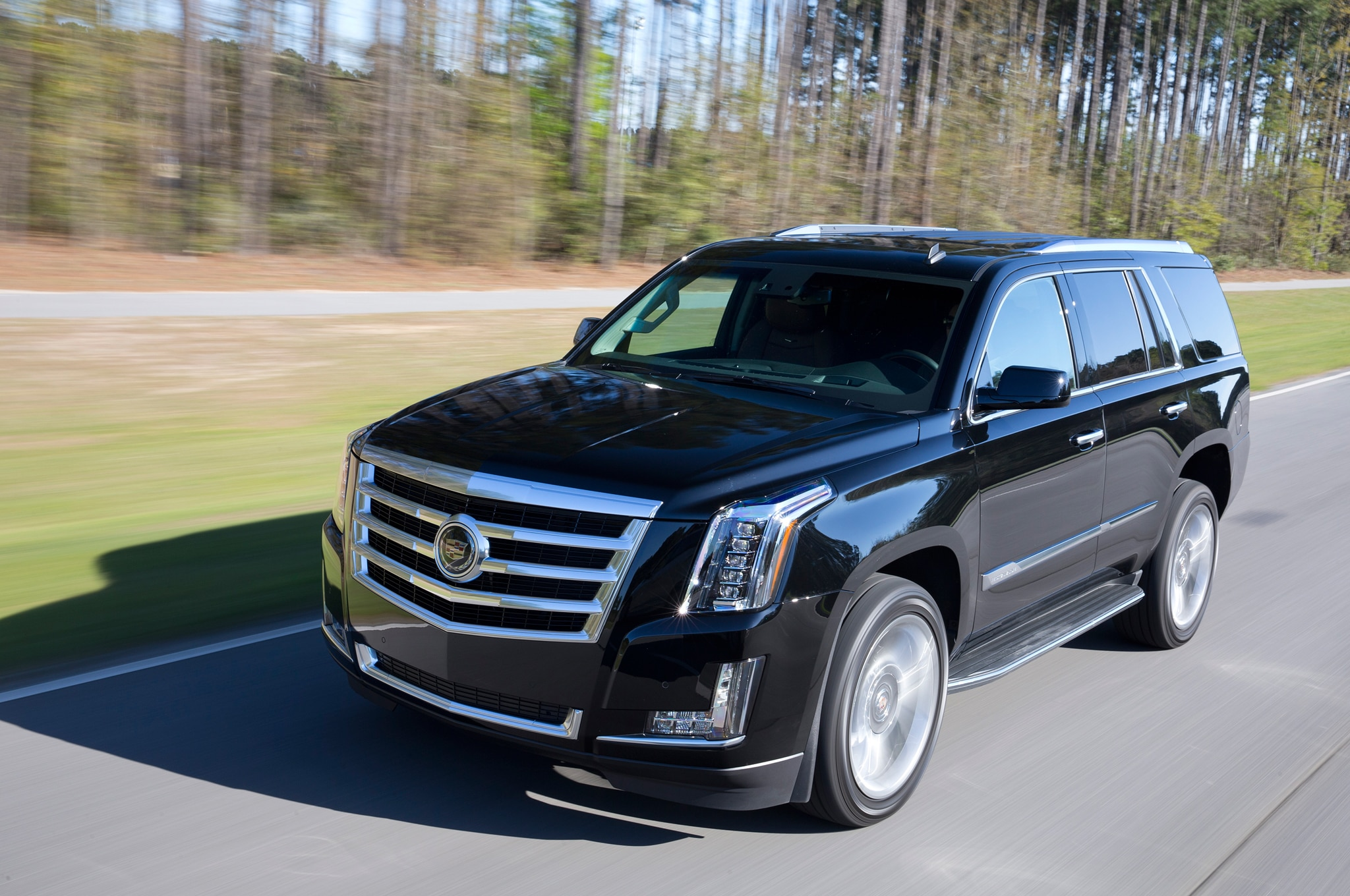 2015 Cadillac Escalade Front Three Quarters In Motion 051