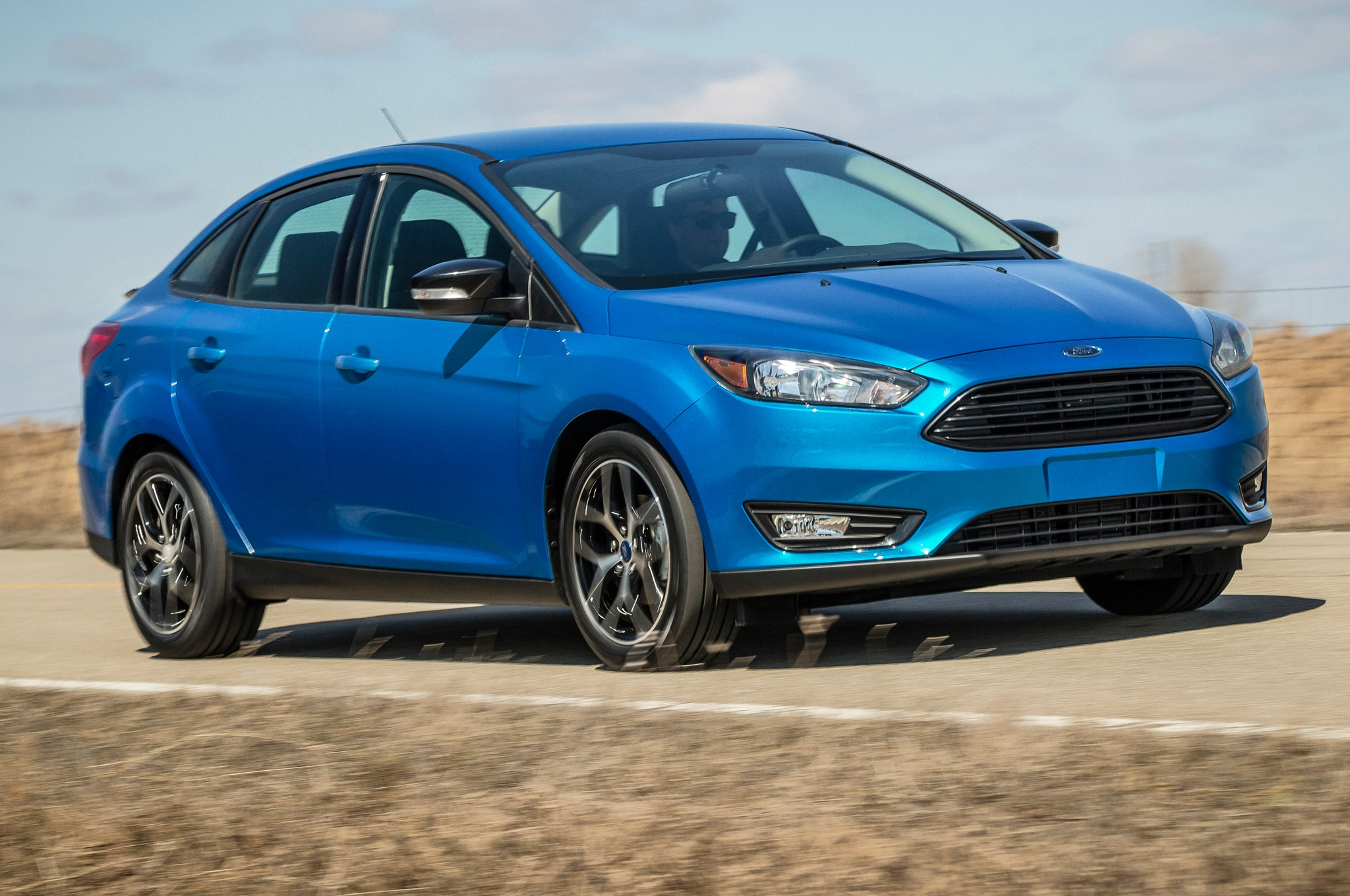 2015 Ford Focus Sedan Front Side Motion View On Road & Ford Moving Small Car Production to Mexico is a Political Red ... markmcfarlin.com