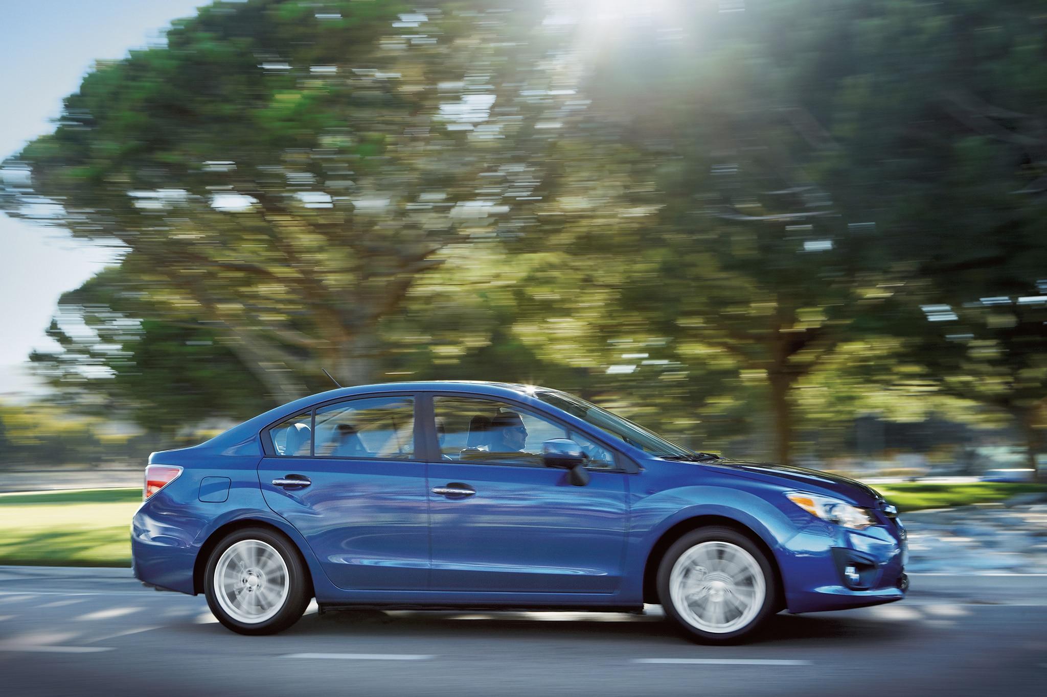 2014 Subaru Impreza Passengers Side In Motion3