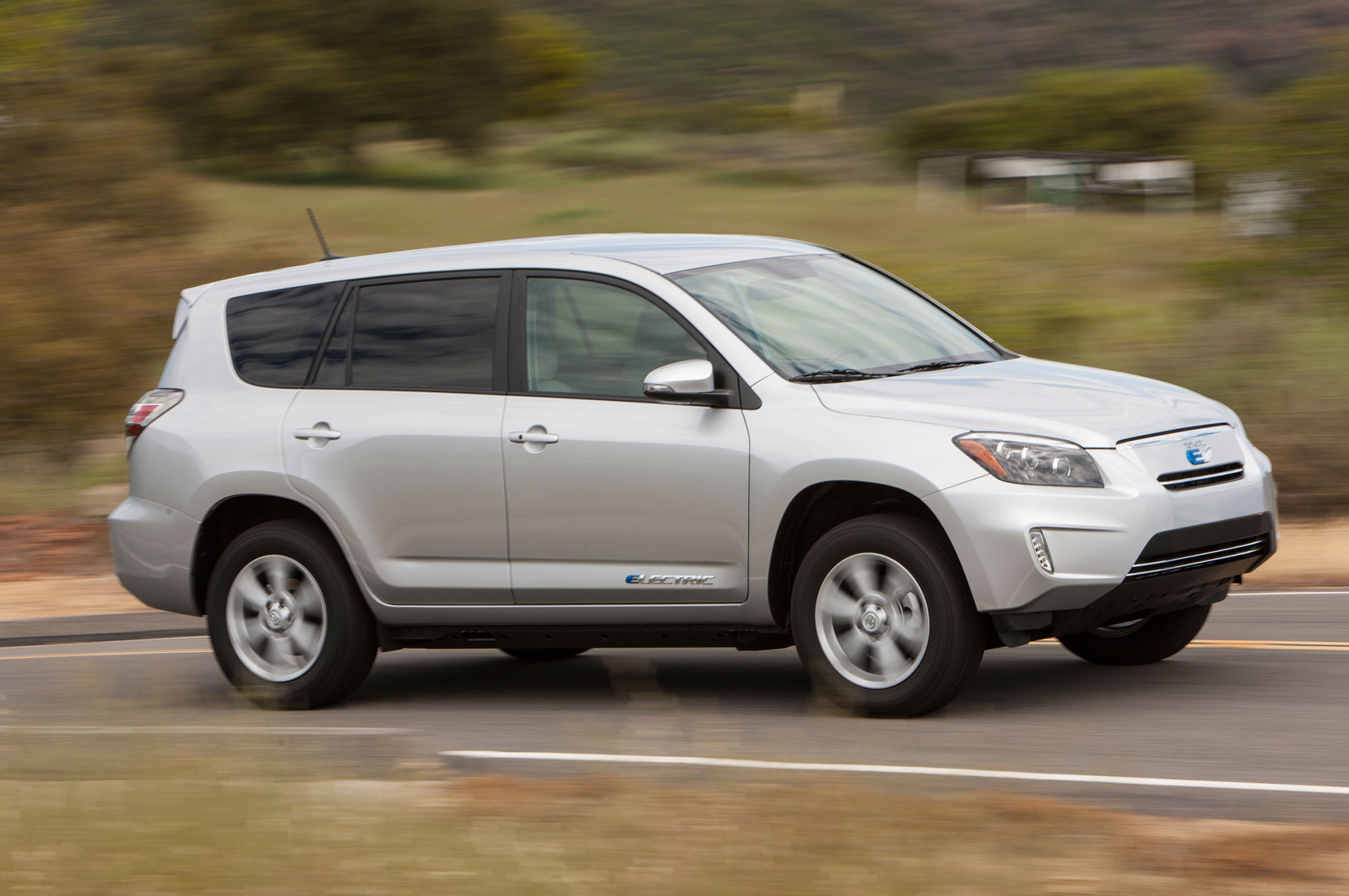 2014 Toyota RAV4 EV In Motion Three Quarters Front View 0031
