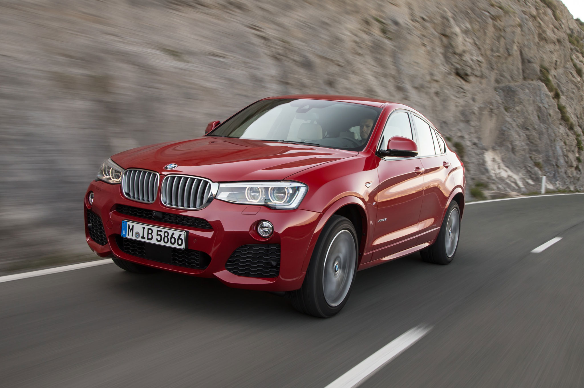 2015 BMW X4 Front Side View Down Road1