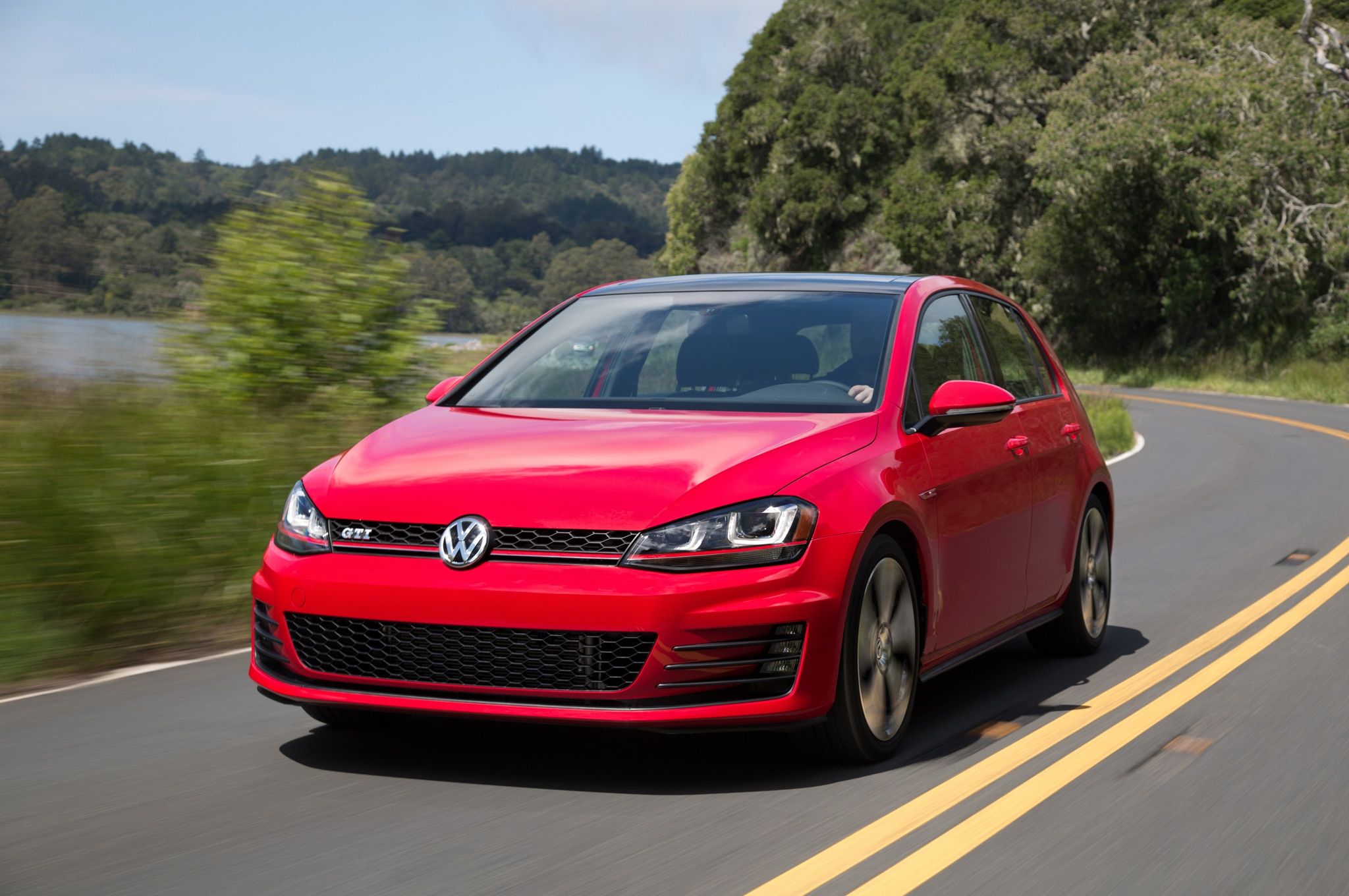 2015 Volkswagen Golf GTI Front Three Quarter In Motion1